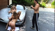 Two young blondes love his fast car and his cock in their hot holes in the driveway