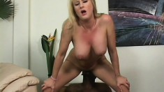 Busty blonde bitch with a nice butt gets slammed by a black cock