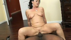 Luscious mature woman with big boobs feeds her desire for black cock